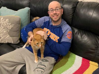 Teddy sitting with orange tabby Jeter