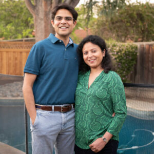 Mukund and Neelu in front of pool