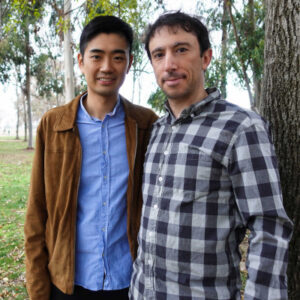 Rui and Neal together in front of trees