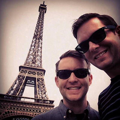 Chris and Nick in front of Eiffel tower, sepia vignette style