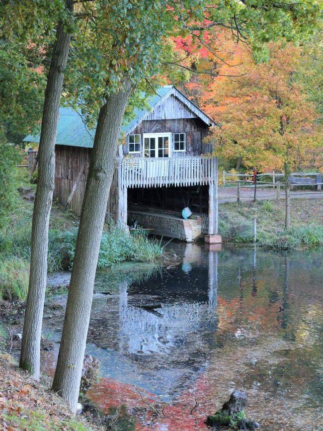 Lake boathouse Winkworth Arboretum