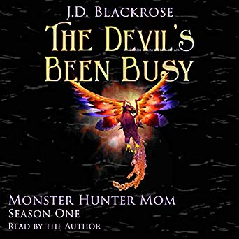 Cover of The Devil's Been Busy with multicolored phoenix