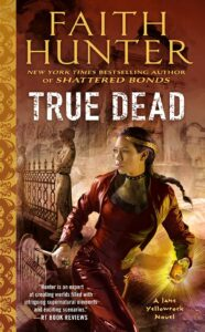 Cover of Faith Hunter's True Dead book, woman in red leather with long dark braid and gold crown