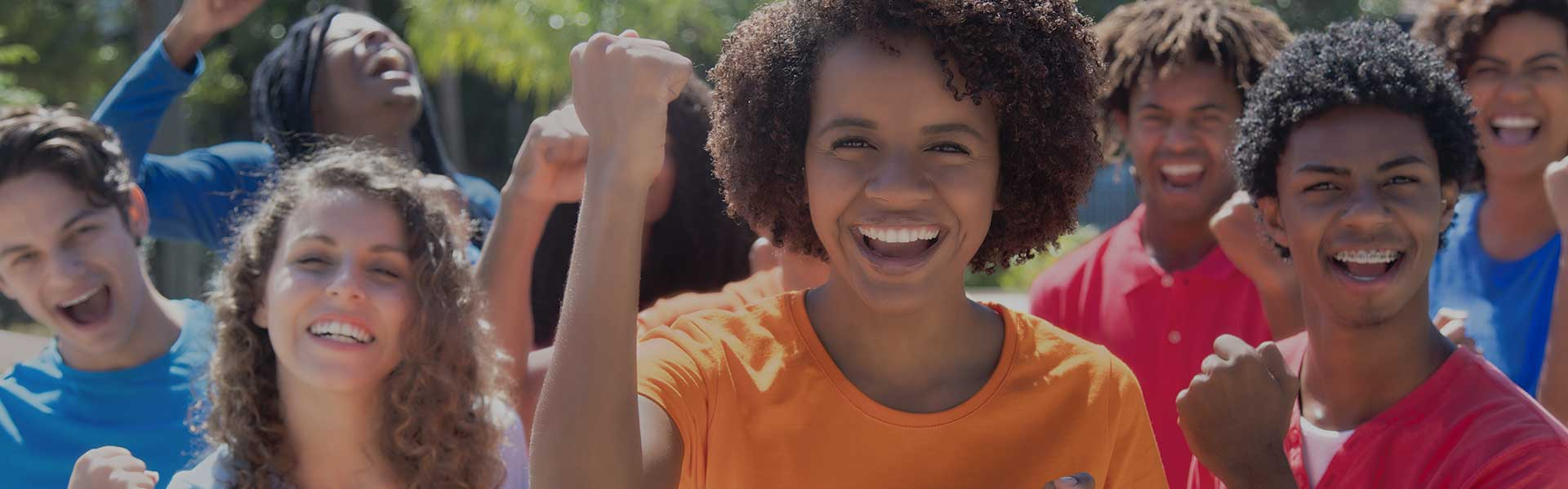 smiling students with fist pumping