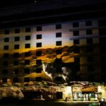 Wildhorse Projection Mapping on Exterior of Building Sunset Desert Landscape
