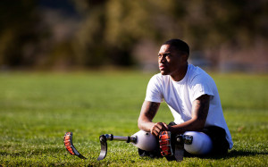 Cpl. Anthony McDaniel, a bilateral leg amputee, stretches before practice for the 2012 Marine Corps Trials