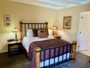 The queen bed in Suite 3