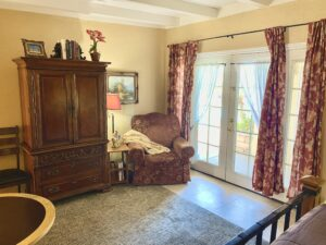 The glass French doors in Suite 3 featuring an armoire cabinet