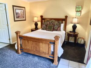 The queen bed in suite 4