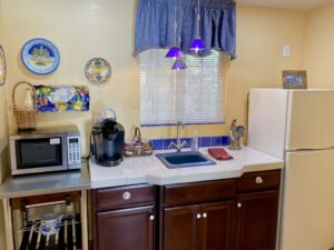 The kitchenette in suite 7 featuring a sink, Refrigerator, Microwave, and Keurig Coffeemaker