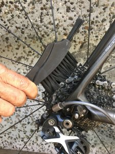 Remove grime with long bristled brush