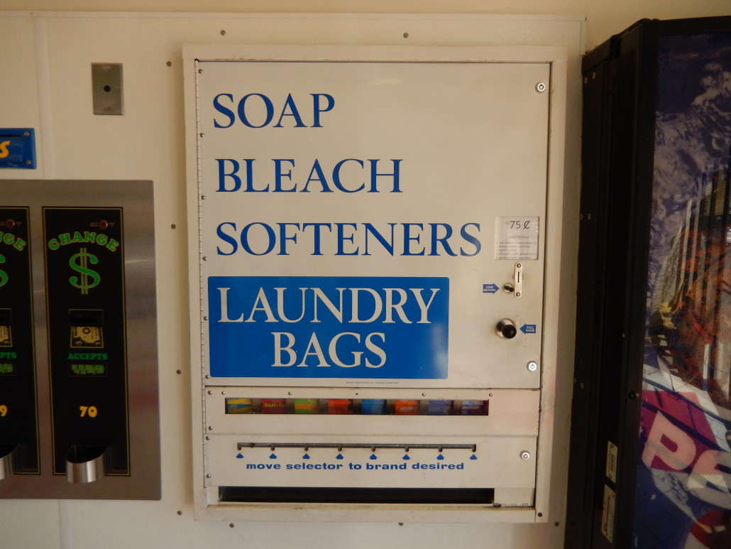 Soap bleach softeners and laundry bag dispenser at Walden Square Laundromania West Iowa City
