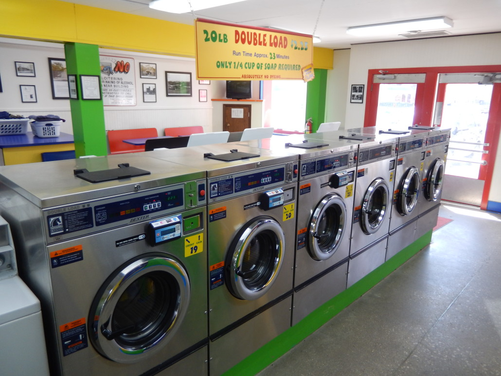 Line of 20lbs front load washers Bloomington Street Laundromania downtown Iowa City