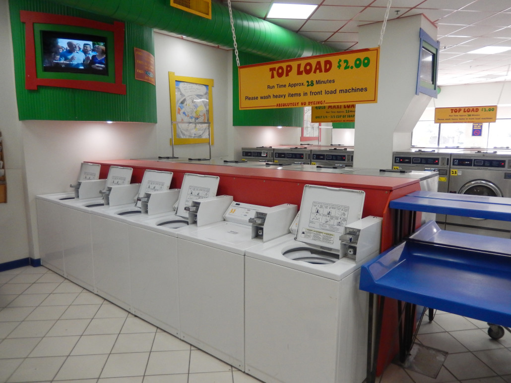 Top load washing machines with TV at Laundromania in North Liberty, Iowa