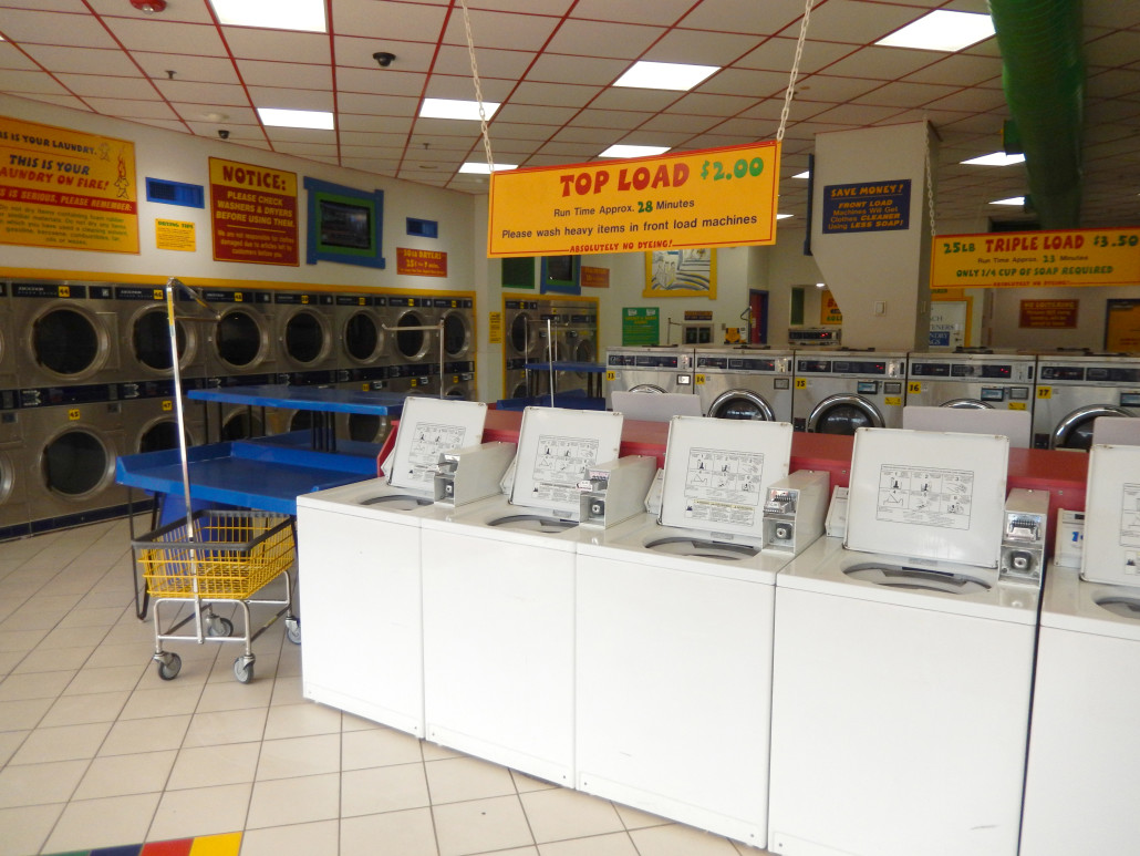 View of top load washing machines at Laundromania in North Liberty, Iowa