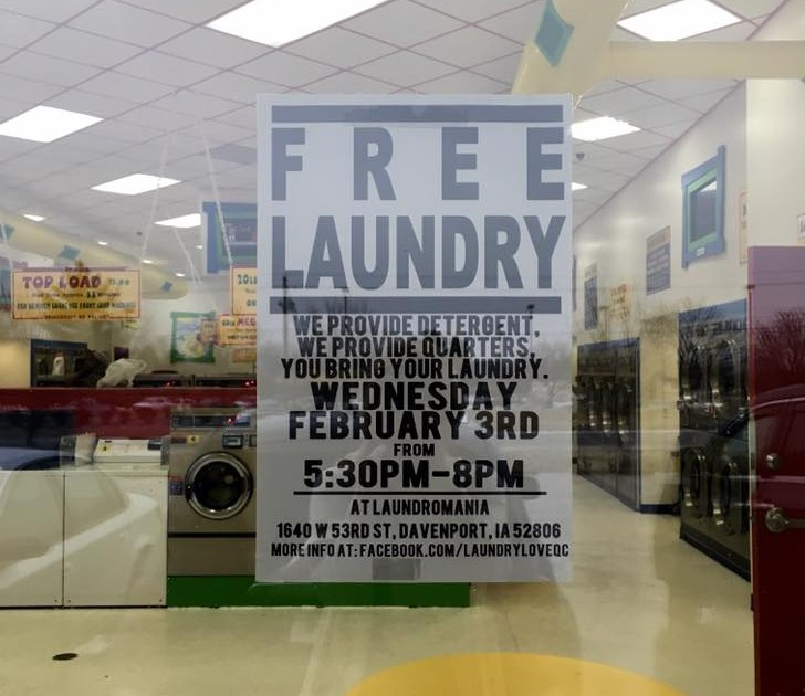 Free Laundry Sign in Laundromat Window