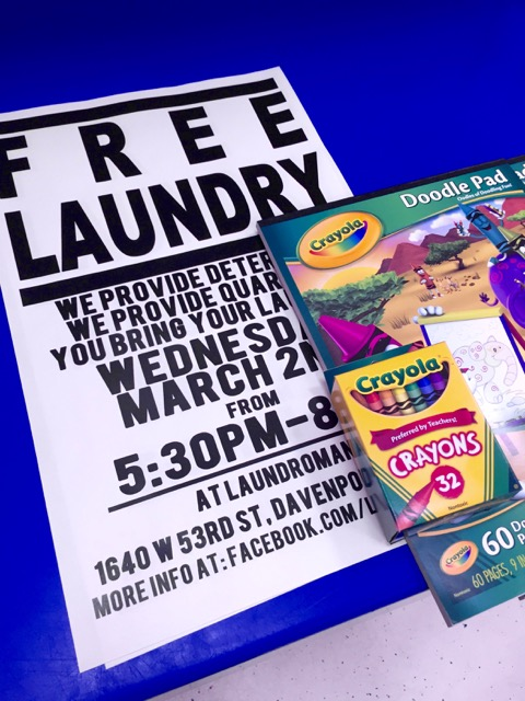 Promotional signage for March Free Laundry Event