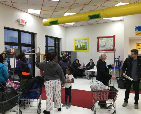 Group of people getting ready to do laundry at Free Laundry Event on Wednesday March 2nd