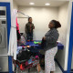 Mother and children at Free Laundry Event on Wednesday March 2nd at Laundromania in Davenport, Iowa