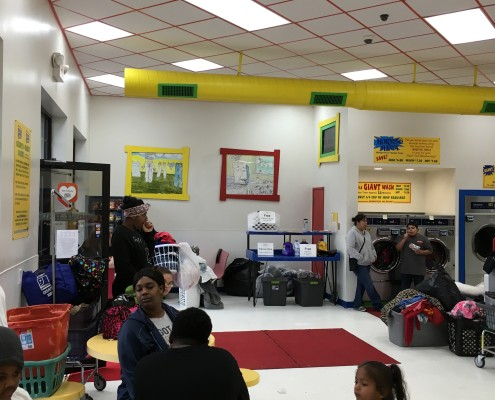 Families waiting for laundry at Free Wednesday event