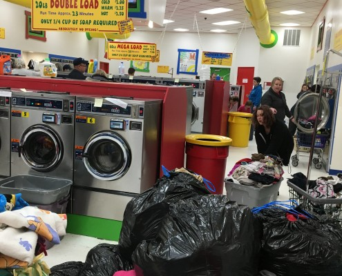 Laundromania packed with laundry on free Wednesday laundry event nights