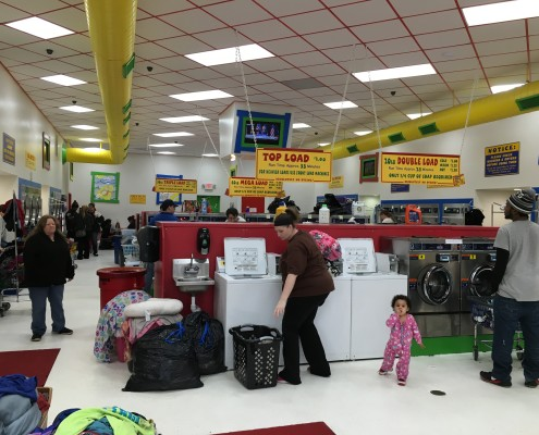 Packed free laundry event on Wednesday April 6 2016 at Laundromania in Davenport, Iowa