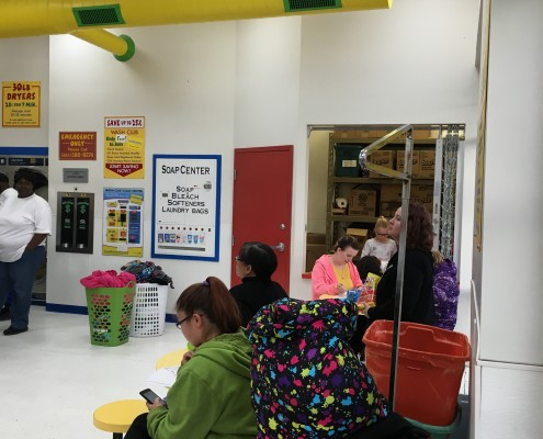 Waiting for laundry on Wednesday April 6 2016 Free Laundry event at Laundromania in Davenport, Iowa