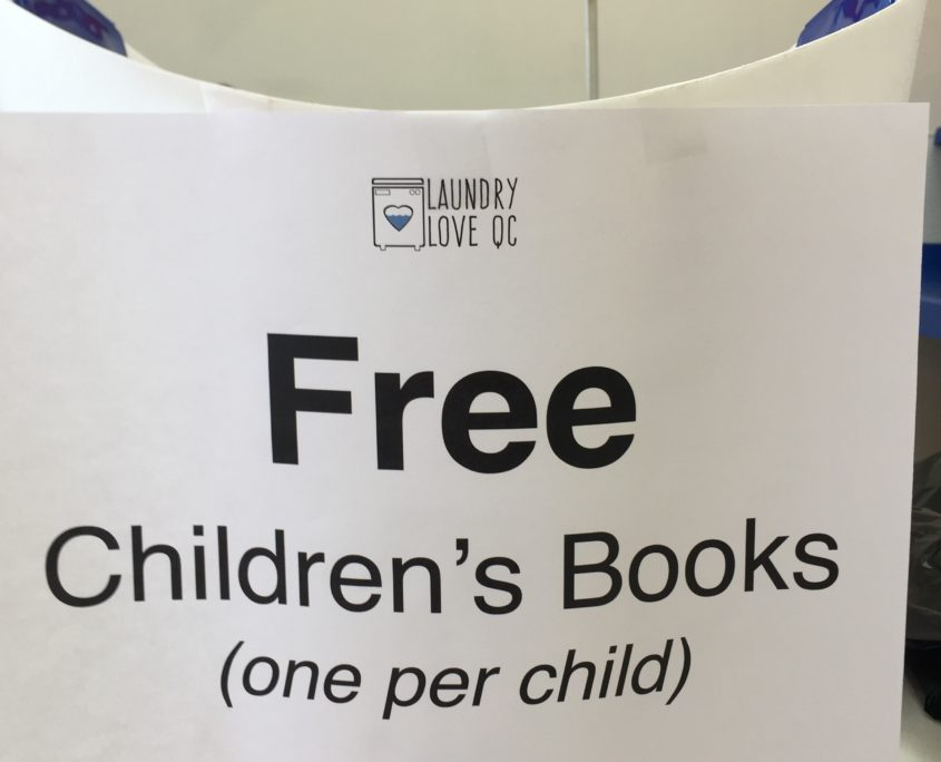 Free children's book give away by Laundry Love QC at Laundromania