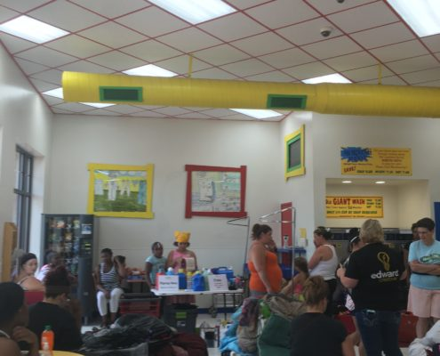 Lots of people for the free laundry event at Laundromania in Davenport Iowa on Wednesday, Aug 3rd 2016