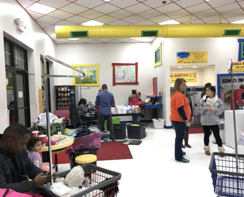 People waiting at the Quad Cities Free Laundry evnt in January 2017