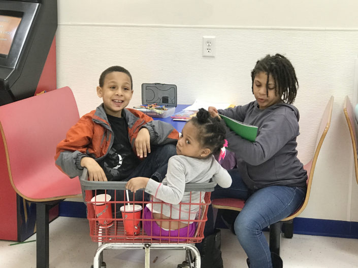 Kids at the Laundry Love QC event at Laundromania in Davenport, Iowa in March