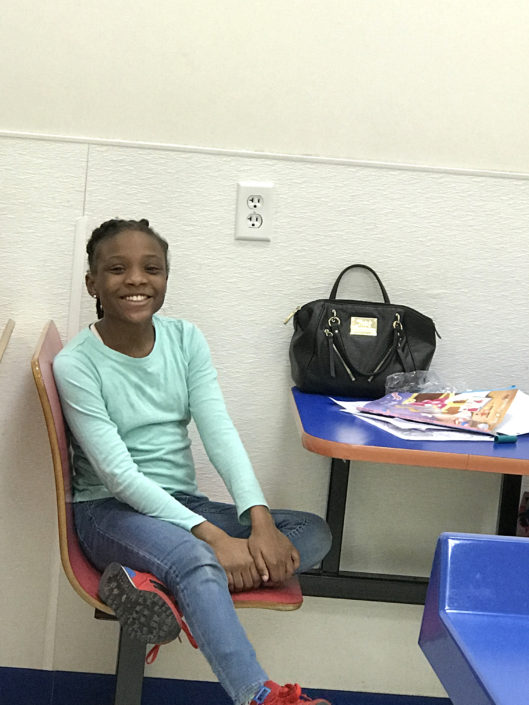 Young lady enjoying the Laundry Love QC event at Laundromania in Davenport, Iowa in March