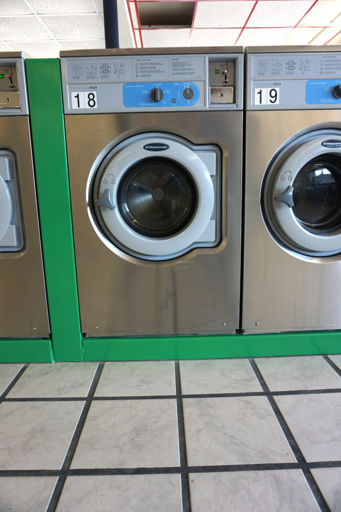 20lb front load washing machine by Wascomat inside Laundromania Coralville 24 hour Laundromat