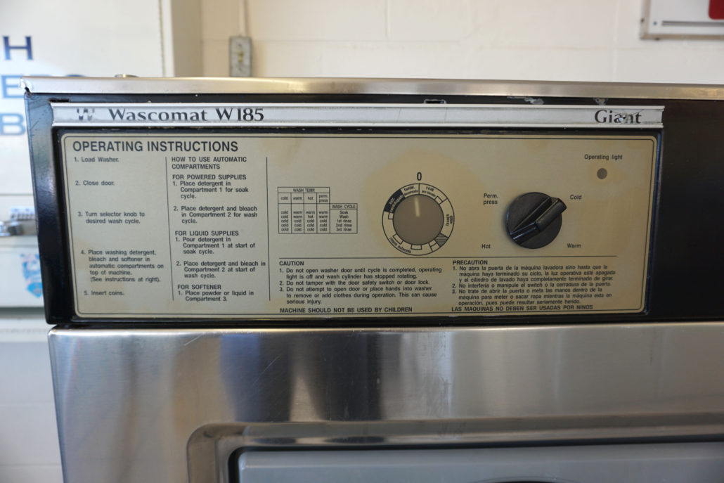 Directions on the 50lb washing machine inside Coralville Laundromania 24 hour Laundromat