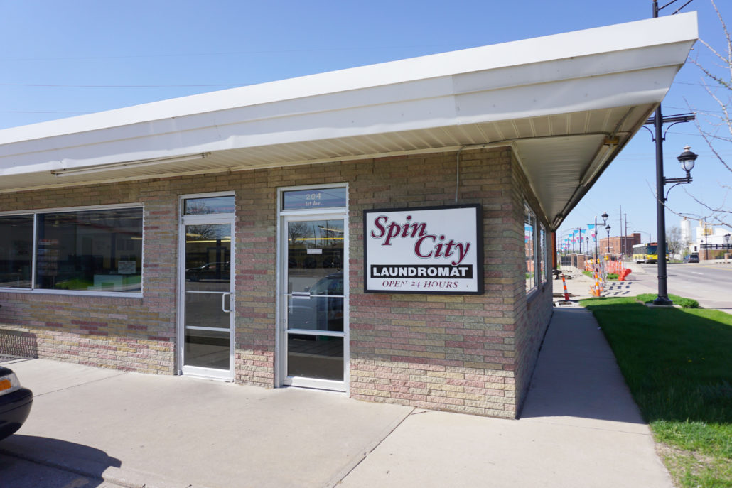 View of Spin City sign on Laundromania Coralville 24 hour Laundromat