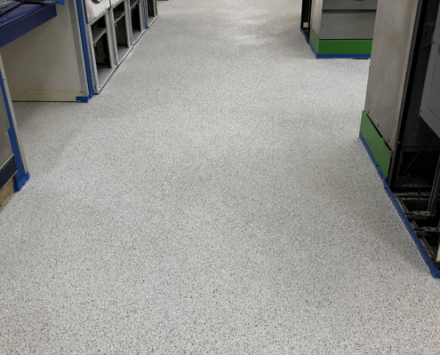 Finished new flooring is installed at the Davenport Laundromania laundromat location