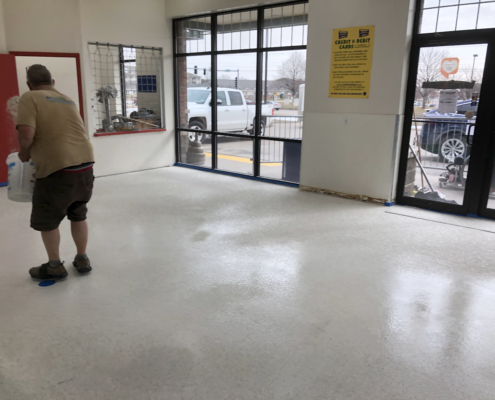 Sprinkles going on the flooring is installed at the Davenport Laundromania laundromat location