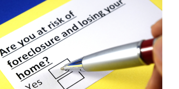 """Sign asking """"are you ate risk of foreclosure and losing your home . there is a box to check that says yes, and one that says no."""