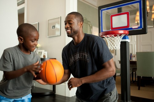 """Dwayne Wade shows fans how he cares for what matters by playing 'dad defense' off the court during his Dove® Men+Care™ """"Real Moments"""" campaign shoot, launching just in time for March Madness."""
