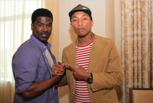 This photo of Glenn Lewis (L) and Pharrell Williams was taken at the 2013 BET Experience.  Pharrell is up for 2  2014 BET Awards.