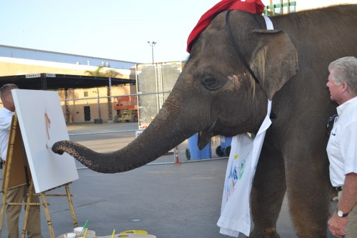 Rosie the painting elephant shows off her fine artist skills.