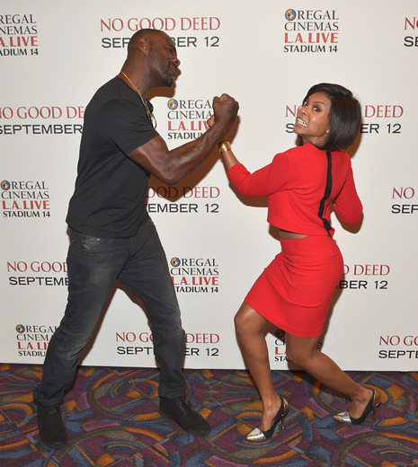 "Idris Elba and Taraji P. Henson have fun while promoting new film ""No Good Deed."" (Photo by Charley Gallay/Getty Images for Screen Gems)"