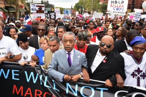 The Reverend Al Sharpton marches with over 2500 peaceful protesters at a rally against police brutality in memory of Eric Garner August 23, 2014 in Staten Island, New York City.   STAN HONDA/AFP/GETTY IMAGES