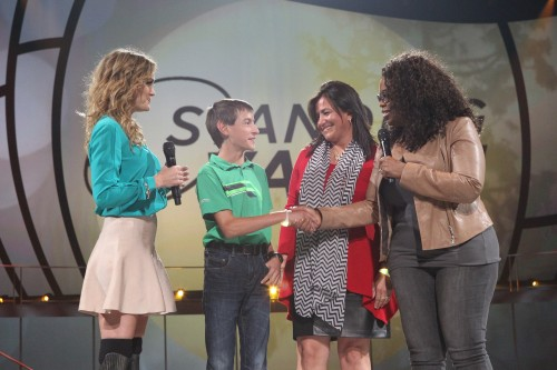 "Oprah Winfrey and Toyota Brand Ambassador Amy Purdy (far left) with Yamile Jackson (second to right), recipient of the Toyota ""Standing O-Vation"" Award, and Yamile's son Zachary (second to left) on Saturday, October 18, 2014 at the Toyota Center in Houston, Texas"