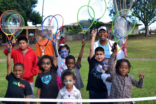 Frances Simpson-Lang, President of the Mountain View Sports and Raquet Association in San Diego, CA with Junior Tennis Players