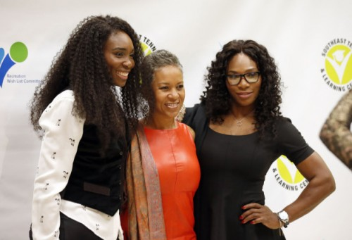 Tennis champions Venus Williams, left, and Serena Williams, right, pose for photographers with Katrina Adams, incoming chairman of the USTA, during a renovation gala at the Southeast Tennis and Learning Center, Friday, Nov. 7, 2014, in Washington. (AP Photo/Alex Brandon)
