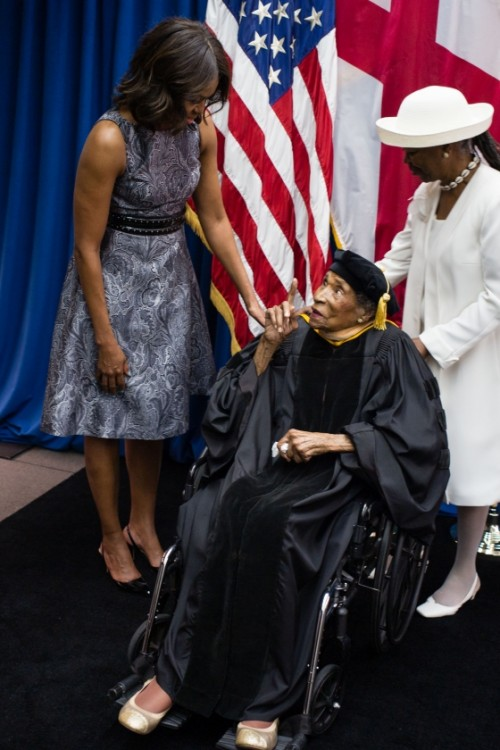 First Lady Michelle Obama greets alum and Selma civil rights leader, Dr. Amelia Boynton Robinson, age 103 and Latifya Mohammed before the Tuskegee University Commencement ceremony in Tuskegee, Ala., May 9, 2015. (Official White House Photo by Chuck Kennedy)