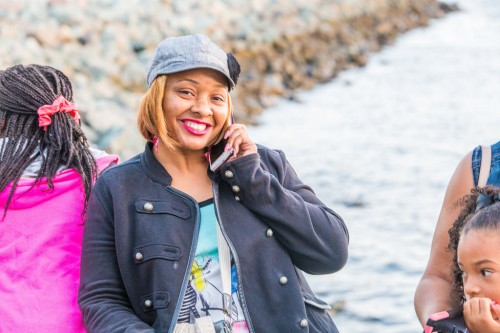 Lekesha of Dallas (Kimora's Mom) poses while on a call at Seaport Village.