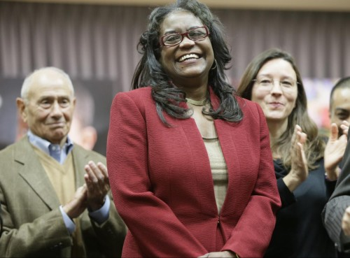 Los Angeles Unified School District Deputy Superintendent Michelle King is named the district's next superintendent by members of the board of education during a news conference in Los Angeles, Monday, Jan. 11, 2016. At left, former Los Angeles Unified School District Superintendent Ramon Cortines. (AP Photo/Damian Dovarganes)