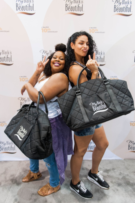 Amber Riley and Jordin Sparks having fun at the My Black is Beautiful booth at Essence Festival 2016.jpg/ Photo red: MBIB